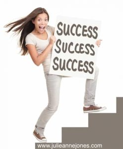 Woman holding success sign