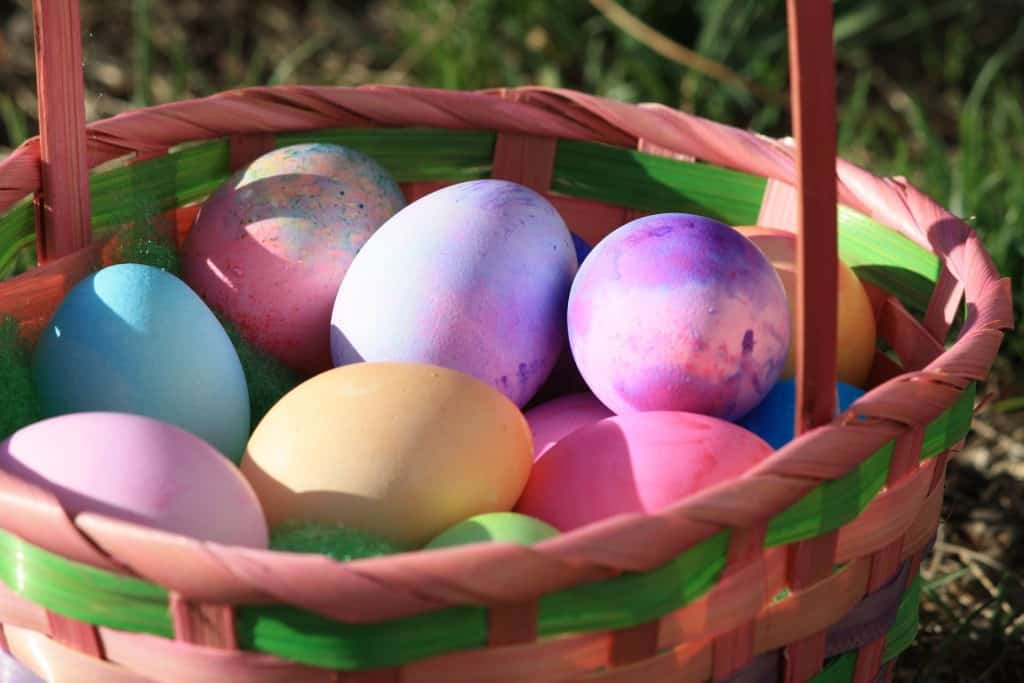 Colored eggs in a unique Easter Basket