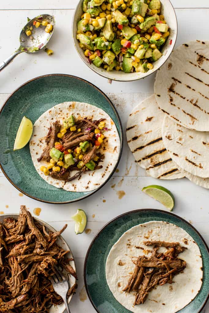 This recipe for Brisket Tacos with Roasted Corn Avocado Salsa will be amazing this 4th of July!