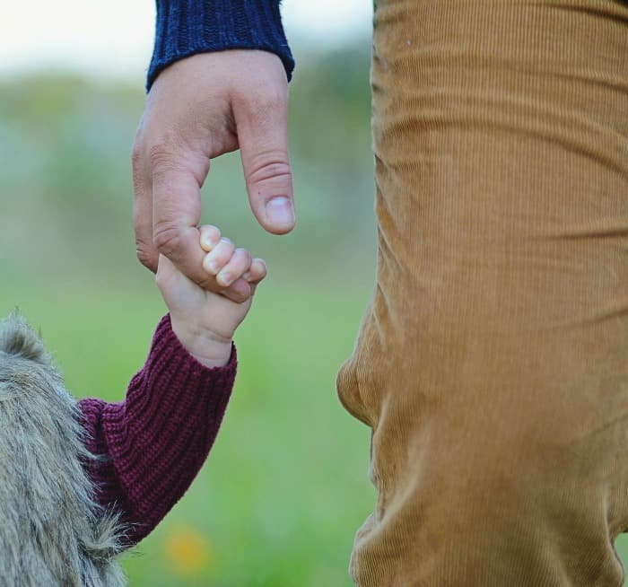 dad holding little daughter's hand