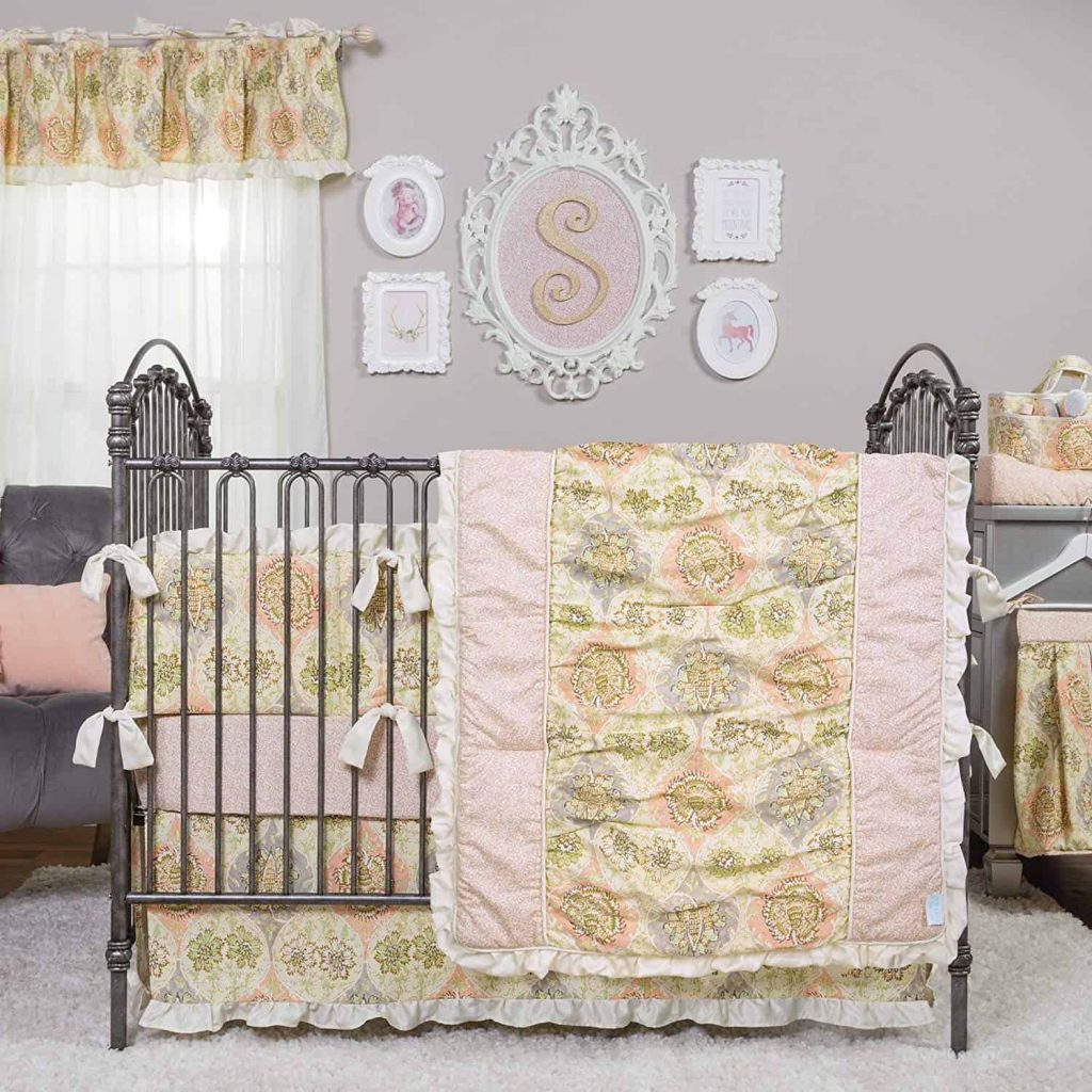 glam nursery ideas including metal crib and glam wall decor