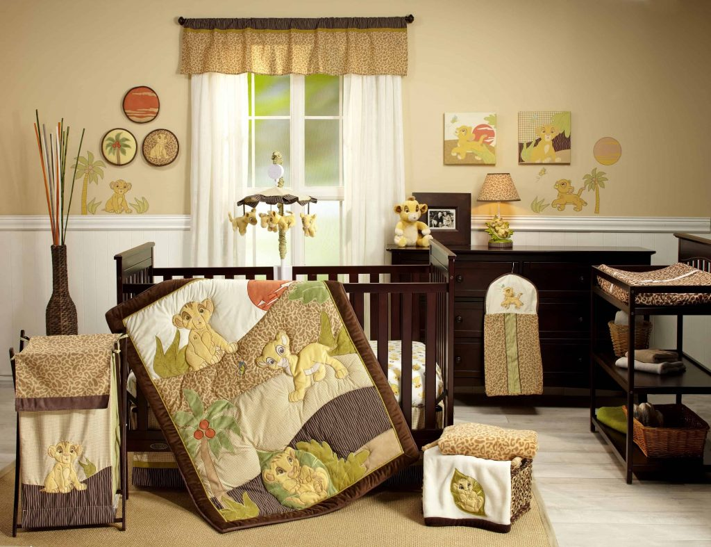 Nursery essentials including crib, changing table, dresser and Disney's Lion King bedding and accessories