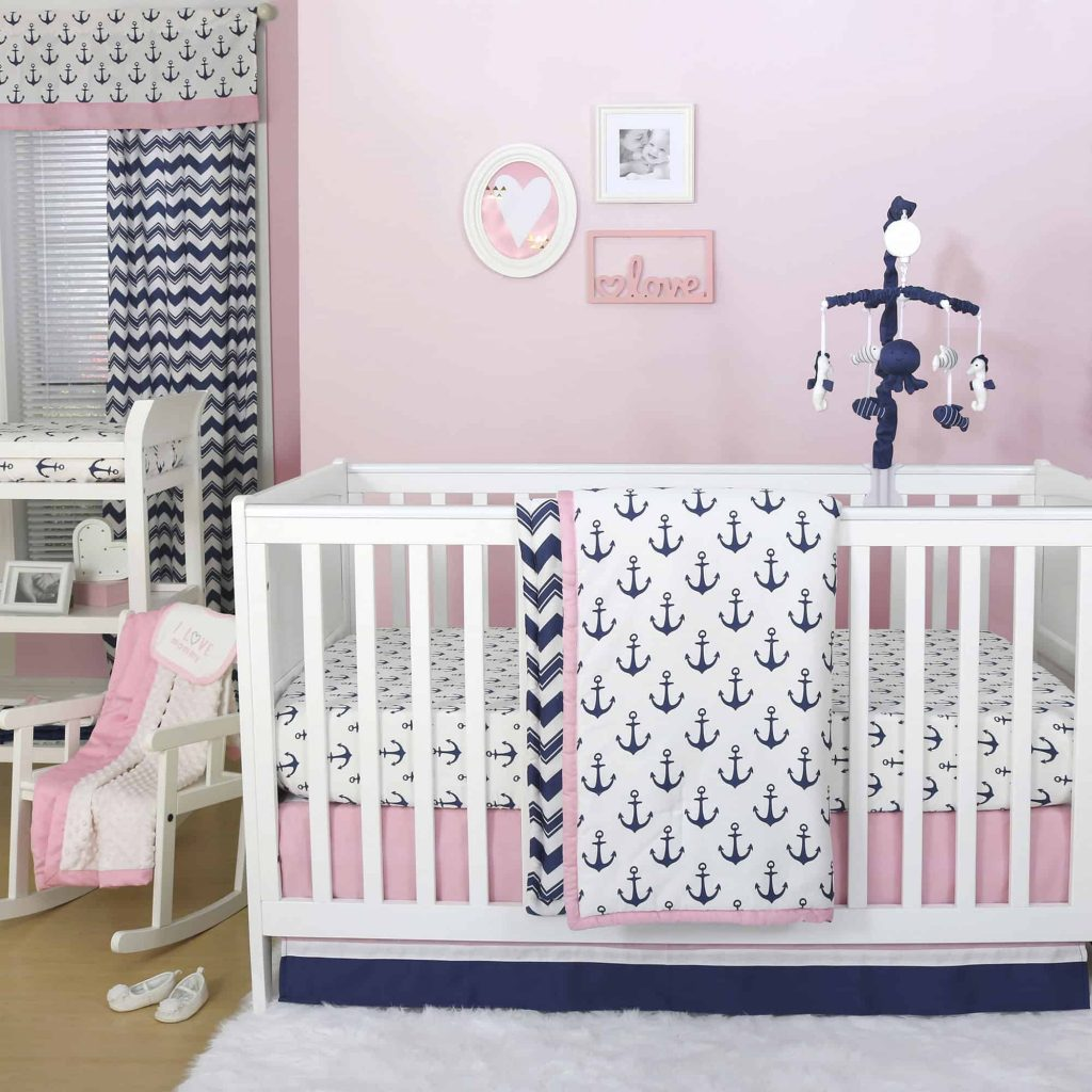 Pink and blue nautical nursery, white crib and nautical decor