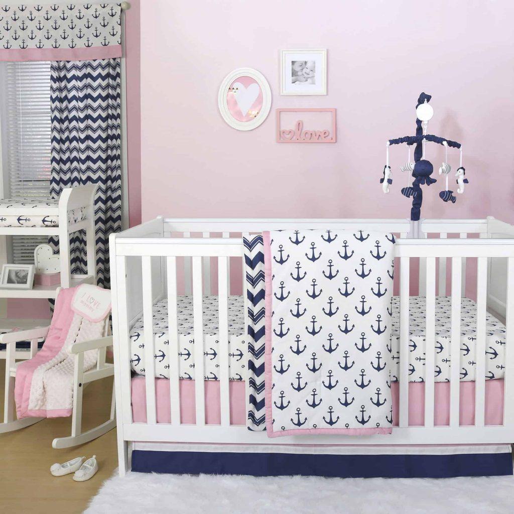 Pink and blue nautical nursery, white crib and nautical decor