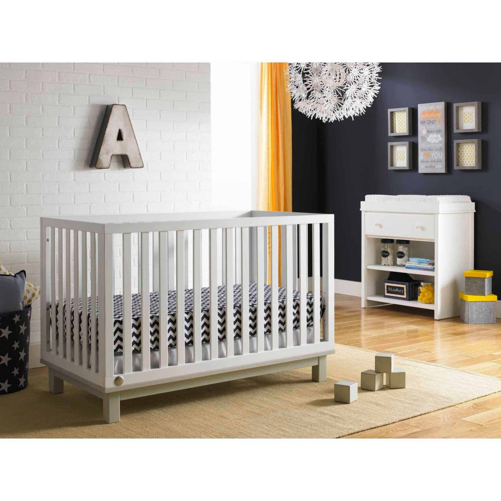baby boy modern nursery including crib and room decor